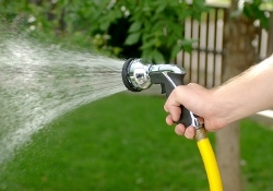 watering your lawn in hot weather
